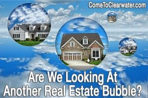 Housing market troubles representing by bubble houses about to burst